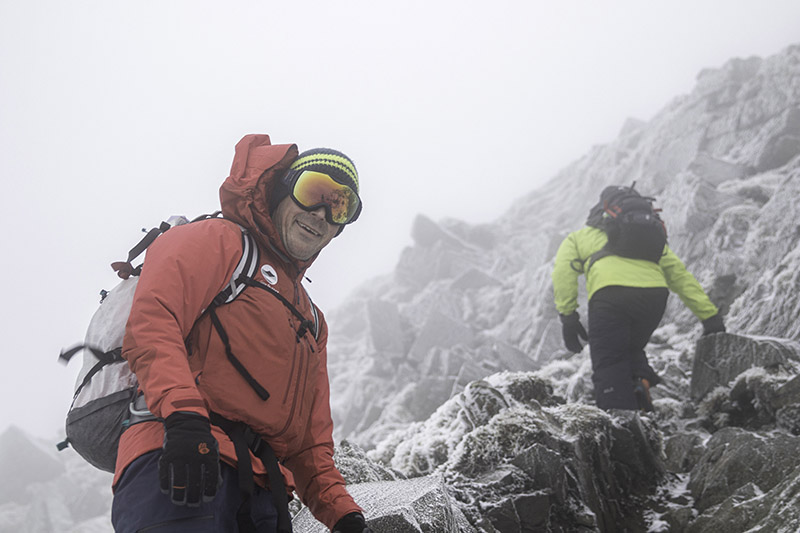Fell Top Assessor on a very cloudy fell top covered in icy rocks.