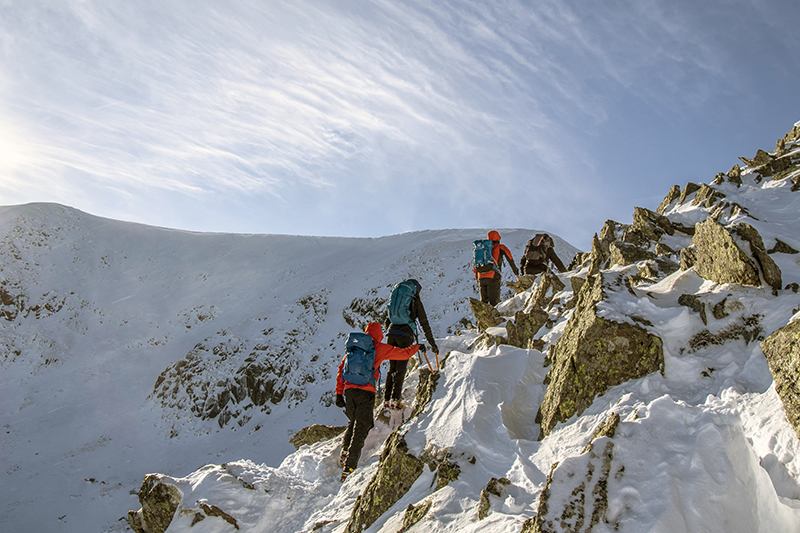 A group of people climbing Helvellyn